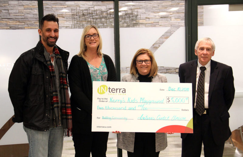 THE CEREMONIAL CHECK, representing the $5,000 DONATION to Kerry's Kids Playground at Hay Park in Goshen, was presented by Interra Credit Union to Mayor Jeremy Stutsman, left, and Tanya Heyde, the superintendent of Parks and Recreation, from Interra CEO Amy Sink and Tim Yoder, Chairman of the Board.