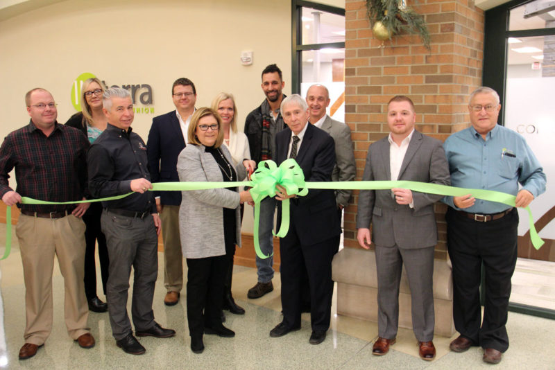 CUTTING THE RIBBON to celebrate the Interra's major corporate office renovation were, from left, Jason Pippenger, president of DJ Construction; Tanya Heyde, superintendent of Goshen Parks and Recreation, Bob Schrock, CEO, DJ Construction; Nick Kiefer, President of Goshen Chamber of Commerce; Amy Sink, Interra CEO; Susan Cripe, Interra Supervisory Committee member; Goshen Mayor Jeremy Stutsman; Tim Yoder, Chairman of the Board; David Birky, Executive Vice President/Chief Strategy Officer; Andy Marshall, Executive Vice President/Chief Operating Officer; and Loren Eash, board member.